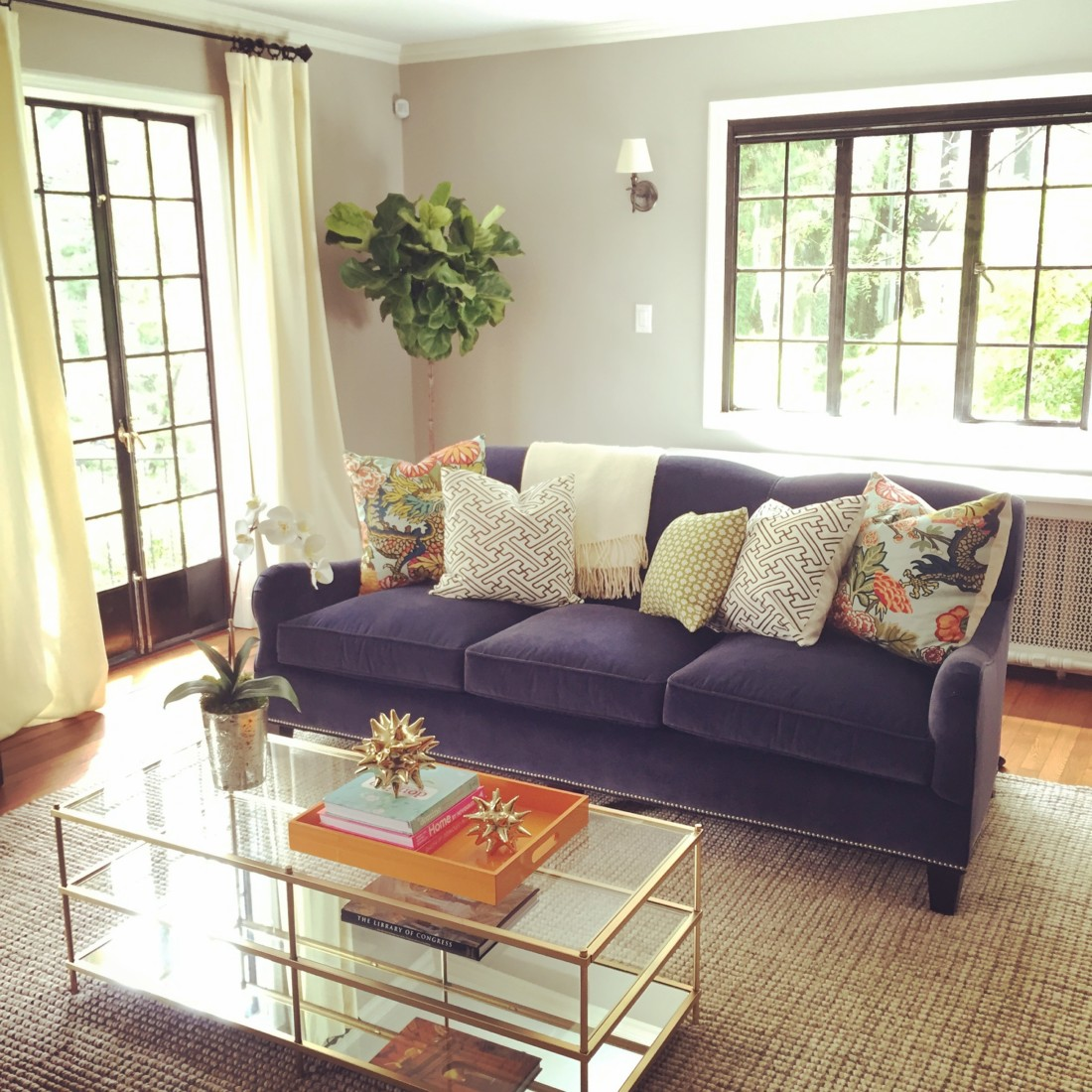 Sunny living room with a purple couch